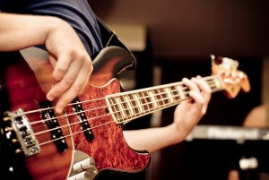 musician playing bass guitar