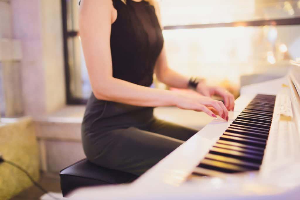 Beautiful lady plays digital piano