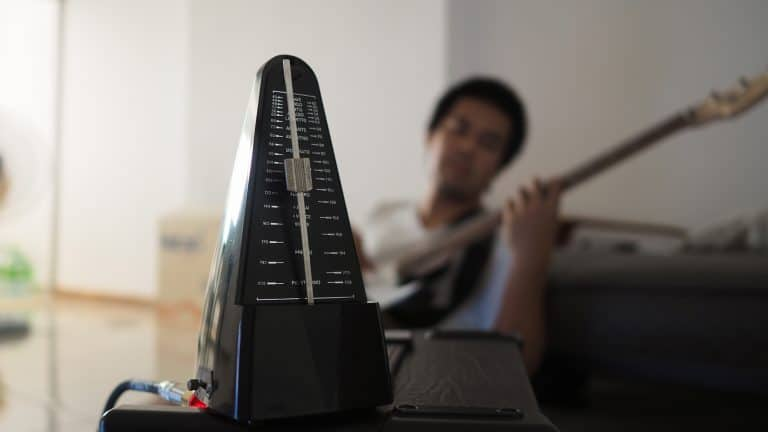 Black metronome is used by musician to keep a steady tempo