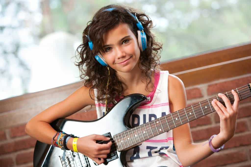 Cute girl with electric guitar