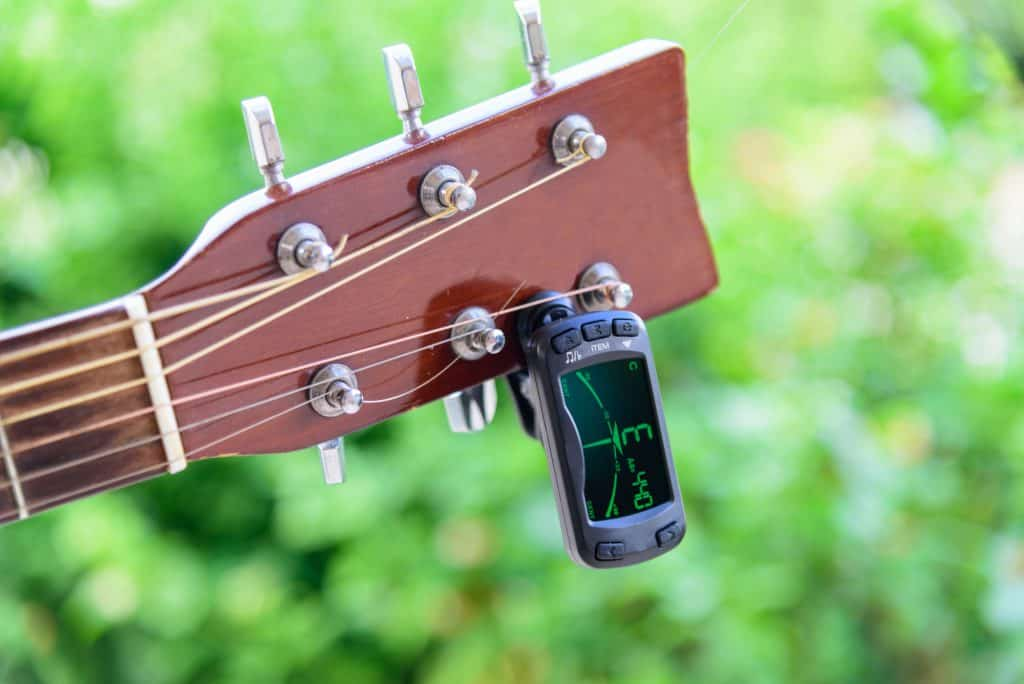 Digital guitar tuner on a guitar headstock