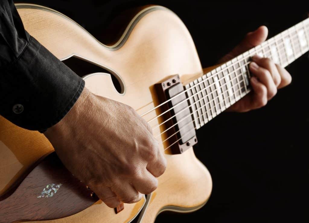 Guitarist plays custom jazz guitar