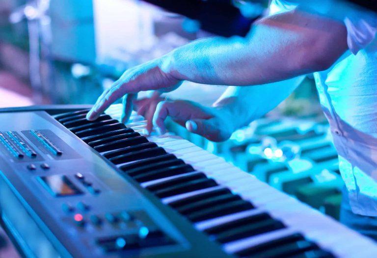 Man playing synthesizer keyboard