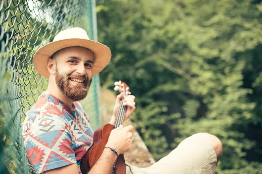 Man playing ukulele in nature