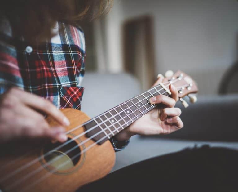 strumming the ukulele